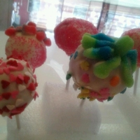 Cake Pops For Valentines strawberry with fluffy white icing/vaniela flavored chocolate. lots of to make and their so cute.