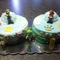 Mario & Luigi Two 10in cakes - frosted in buttercream covered in fondant.