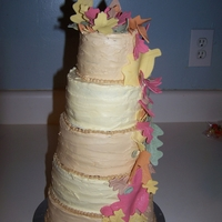 Fall Leaves Caramel Italian Meringue Buttercream and Egg Yolk Buttercream with Fondant leaves dusted with luster dust.