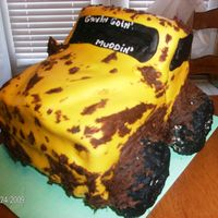 Goin' Muddin' My customer wanted a 3D jeep cake, just like her dad's, resembling it after a time out at the river. With mud splattered all over....