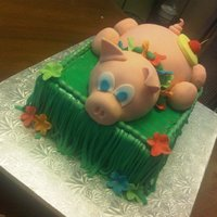 Luau Pig Cake Fondant cake for a Luau Party. The piggy is Rice kirspies covered in fondant.