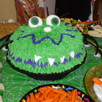 Halloween Monster decorated with buttercream, fondant accents, licorice legs and candy eyes