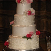 Round Buttercream Wedding This wedding cake is covered with buttercream icing. I used fondant pearls as an accent