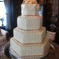 Hexagon Wedding Cake This wedding cake is cover in buttercream with fondant accents