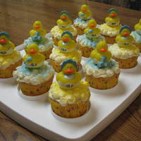 Baby Shower Cupcakes Cupcakes frosted with buttercream, with purchased ducks for decoration.