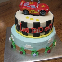 """cars"" Buttercream icing with fondant decorations and purchased car."