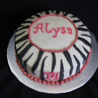 "Zebra Striped Birthday Cake Cake iced with buttercream, fondant stripes, name and ""14"". Was pleased that the zebra stripes worked in the cake...couldn't..."