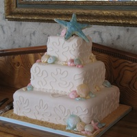 Covered With Fondant Piped Coral Seashells Are Made From White Chocolate And Brushed With Pearl Dust Pearls Are Handmade Giant Star Top Covered with fondant, piped coral, seashells are made from white chocolate and brushed with pearl dust, pearls are handmade, giant star...