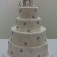 Snowflake Wedding Round and petal shaped wedding cake with edible snowflakes. TFL