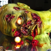 Zombie Zombie cake for a 41st birthday. I had too much fun with the details!!