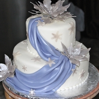 25Th Winter Anniversary Cake Draped in fondant and accented with gum paste silver poinsettias and snowflakes,