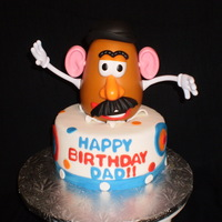 Mr. Potato Head  'Puertorican' cake covered with fondant. Birthday guy favorite toy was potato head. Wife bring the decoration. It has a button...