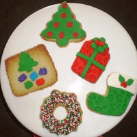 Christmas Cookies   Orange flavored cookies with fondant decorations.