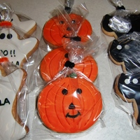 Halloween Cookies   Orange flavored cookies with fondant decorations.
