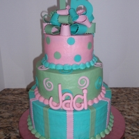 "Jaci's Sweet 16 I haven't posted a picture in ages! I made this cake for my niece's Sweet 16. 5""-7""-9"" buttercream icing with..."