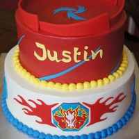 Beyblades Themed Cake I had no idea what Beyblades were, but after much googling, this is what I came up with... a beyblade stadium, and the boy's favorite...