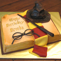 Harry Potter Cake For a harry potter fan. Book sculpted from a 9x13 sheet cake. Sorting hat is cake. Yellow cake with canned choc frosting (as requested by...
