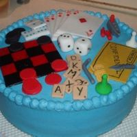Game Night! All pieces hand made out of fondant. Clue, Cards, Dice, Dominos, Battleship, Checkers and Scrabble.