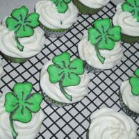 St Patrick's Day Cupcakes Green dyed white cupcake with royal icing shamrocks