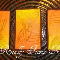 Color Fade Leaf Cookies Chocolate roll out cookies with color fading fondant and leaf design.