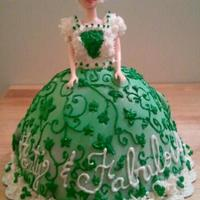 Fab 40 Doll cake covered in fondant and hand piped details.