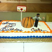 Basketball Cake This cake was made for a gentleman who was a referee and loved basketball. He loves the New York Knicks, being a referee, it was for his...