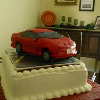 Red 3-D Pontiac Firebird Car Cake 3-d red Pontiac Firebird car cake. Fondant, butter cream grooms cake