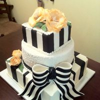 Black And White Wedding Cake With Orange Peonies