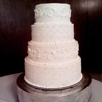 Bling, Pearl, And Scroll Wedding Cake This cake has a quilted design with pearls and bling on every other intersection, It also has scroll work on every other tier. All butter...
