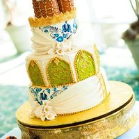 Russian Herritage Wedding Cake Whimsical wedding cake with architectural details of old Russian historical buildings, patterns, colors and gold accents.