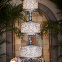 Silver Lace Wedding Cake This 3 tier ivory wedding cake with sugar silver lace was displayed at historical Crosley mansion. Silver chandeliers with crystals were...