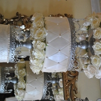 Wedding Cake And Cupcakes Ivory wedding cake with fondant swags, quilt design and edible pearls. Displayed on silver chandelier with crystals. 4 dozen of fresh ivory...