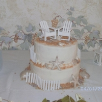 Beach Themed Bridal Shower Cake Beach themed cake. Yellow cake, white buttercream, chocolate seashells.