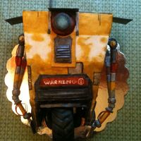 Claptrap Birthday Cake Cake made for my son's birthday. Borderlands is a video game he loves and this is the Claptrap from the game. Fondant and gumpaste....