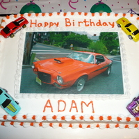 Camaro Birthday Cake The edible image photo is a photo of my son driving his 1973 Camaro. Hot Wheels were added after I put the image on the sheet cake.
