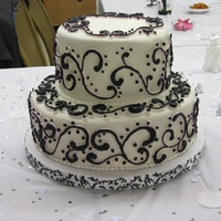 Black And White Scroll Red Velvet cake with cream cheese frosting covered with MMF. With Black on White scroll work with buttercream