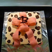 "Leopard & Pink Cake is covered in BC and spots are BC too. The bow is fondant, roses BC and the ""B"" store bought. Loved making this cake!!!"