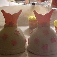 First Fondant Creation Mini dress cakes. Made for my daughter and niece's princess tea. Used mini wonder mold pan. They need work, but I;m pretty proud of...