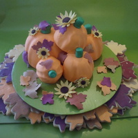 The Pumpkins Are Care Covered With Fondant Decorated With Gumpaste Flowers And Leave I Matched Sugar Cookies With The Fall Themecolors   The pumpkins are care covered with fondant decorated with gumpaste flowers and leave, I matched sugar cookies with the fall theme/colors.