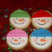 Snowman Sugar Cookies Sugar cookies covered with fondant.