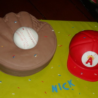 Baseball Glove And Hat 10inch circle cake carved to shape glove, 6inch half ball for hat and mini ball for baseball, all covered in fondant.