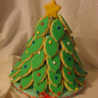 Cookie Christmas Tree   Sugar Cookies covered with fondant.
