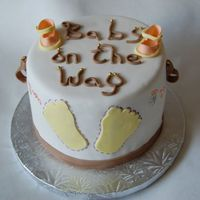 Baby Shower   Fondant cake. The shoes are also made from gum paste.