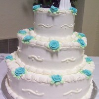 White With Blue Roses All buttercream. White cake. simple blue roses design.