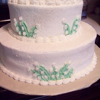 Lily Of The Valley Anniversary Cake All Buttercream. Lily of the valley flowers. White cake. For a 50th Anniversary, A remake of their original. An original wedding photo will...