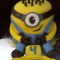 Despicable Me Birthday Cake created with 5 8 inch rounds stacked and carved a little,all fondant decorated.