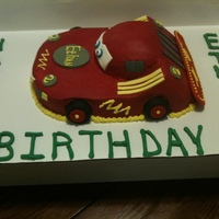 Race Car Cake carved wasc with fondant accent for a happy 2 year old who loves cars