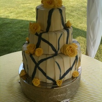 Yellow & Blue I think this cake gave me 100 more gray hairs. 2 flavors - Chocolate with rasberry buttercream and italian cream with cream cheese filling...