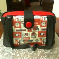 "Uga Purse Cake This cake was made for an auction to raise money for a drive for ""Christmas for Kids"" Yellow cake with buttercream."