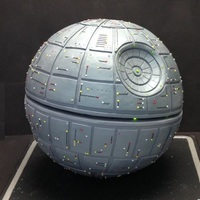 "Death Star Groom's Cake Death Star Groom's cake. 18"" diameter. Blinking lights. Top half cake. Bottom half styrofoam"